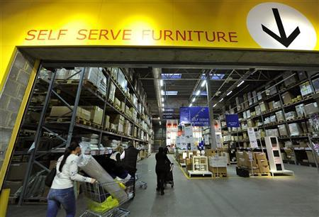 Shoppers push trolleys into Ikea's self service area at the Wembley branch of the Swedish international furniture and home accessories company in west London October 15, 2010. REUTERS/Toby Melville/Files