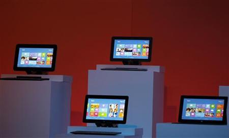 Devices running Windows 8 operating system are shown at the launch of Windows 8 operating system in New York, October 25, 2012. REUTERS/Lucas Jackson