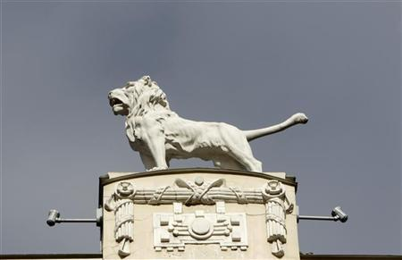 A sculpture of a lion on the top of the Art Nouveau building is pictured in Riga March 13, 2012. REUTERS/Ints Kalnins