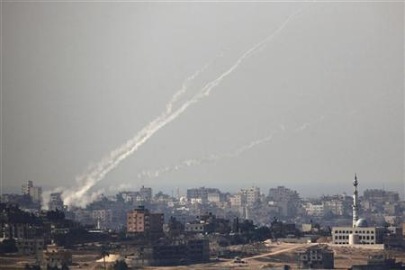 Trails of smoke are seen after the launch of rockets from the northern Gaza strip towards Israel October 24, 2012. REUTERS/Amir Cohen