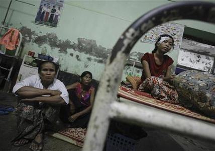 Hla Hla Myint, a victim of recent violence with a head gunshot wound, rests in a bed at a hospital in Kyuktaw township October 25, 2012. REUTERS/Soe Zeya Tun