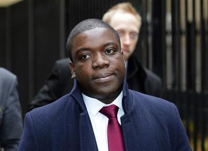 Former UBS trader Kweku Adoboli arrives at Southwark Crown Court in London October 26, 2012. Adoboli is on trial accused of fraud and false accounting that cost the Swiss bank $2.3 billion. He has pleaded not guilty. REUTERS/Paul Hackett