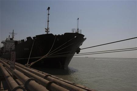 A ship docks at the Bandar Imam Khomeini port in Khuzestan province,1032 km (641 miles) southwest of Tehran September 28, 2011. REUTERS/Raheb Homavandi