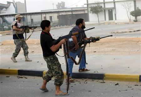 Libyan militias shoot at a building in center of Bani Walid October 24, 2012. REUTERS/Ismail Zitouny
