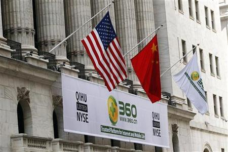 A sign advertising the Qihoo 360 Technology Co Ltd is hung with the U.S. and Chinese flags outside of the New York Stock Exchange before the company's Initial Public Offering (IPO) in New York March 30, 2011. REUTERS/Lucas Jackson (