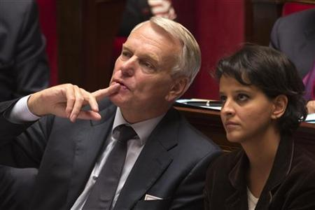 France's Prime Minister Jean-Marc Ayrault (L) sits with the Minister for Women's Rights and Government Spokesperson Najat Vallaud-Belkacem at the National Assembly in Paris October 23, 2012. REUTERS/Charles Platiau