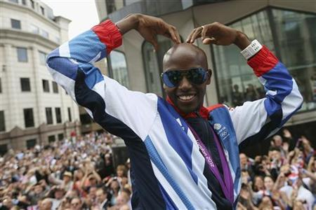 Long distance runner Mo Farah makes his trademark ''Mobot'' pose during a parade of British Olympic and Paralympic athletes through London September 10, 2012. REUTERS/Dan Kitwood/Pool