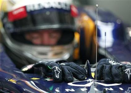 Red Bull Formula One driver Sebastian Vettel of Germany sits in his car during the second practice session of the Indian F1 Grand Prix at the Buddh International Circuit in Greater Noida, on the outskirts of New Delhi, October 26, 2012. REUTERS/Adnan Abidi