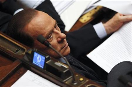 Former Italian Prime Minister Silvio Berlusconi looks on during a vote of confidence at the Lower House of Parliament in Rome November 18, 2011. REUTERS/Tony Gentile