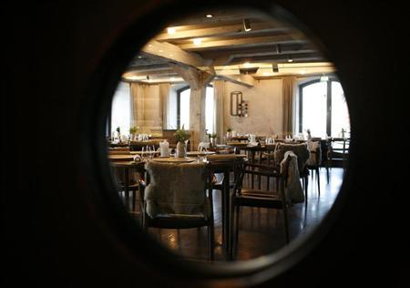 The Noma restaurant run by chef Rene Redzepi is seen in Copenhagen in this picture taken through a window on December 12, 2009. REUTERS/Christian Charisius