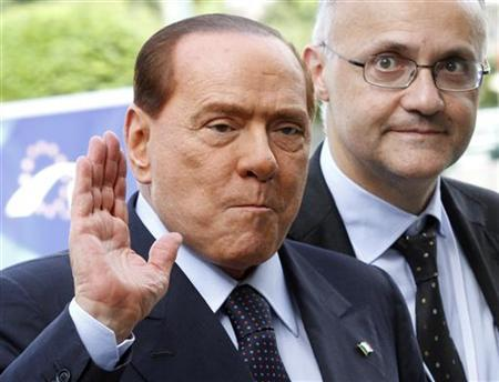 Silvio Berlusconi (L) in Brussels June 28, 2012. REUTERS/Sebastien Pirlet