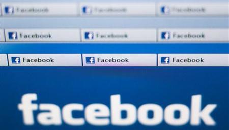 Facebook website pages opened in an internet browser are seen in this photo illustration taken in Lavigny May 16, 2012. REUTERS/Valentin Flauraud