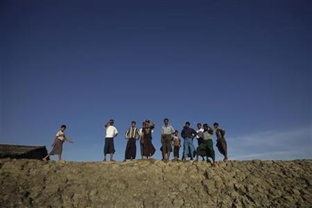 Muslims look out for possible boats bringing more refugees to their camp in Sittwe October 26, 2012. REUTERS/Soe Zeya Tun