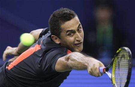 Nicolas Almagro of Spain hits a return during his single's tennis match against Tommy Haas of Germany at the Shanghai Masters tournament in Shanghai October 8, 2012. REUTERS/Carlos Barria