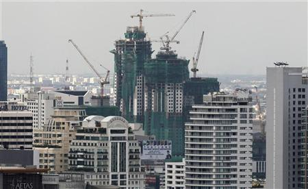 An office building under construction is seen in Bangkok?s business district July 28, 2011.REUTERS/Sukree Sukplang