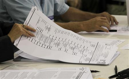 Palm Beach County elections workers hand-copy absentee ballots at the agency's warehouse in Riviera Beach, Florida October 26, 2012. REUTERS/Joe Skipper