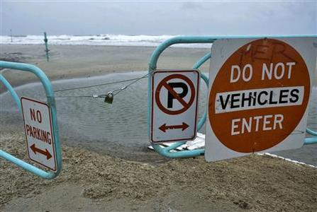 A padlock holds an entrance gate closed to block vehicle access to the beach in Daytona Beach, Florida, as Hurricane Sandy passes offshore October 26, 2012. REUTERS/Steve Nesius