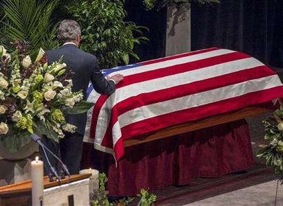 Former U.S. Senate Majority Leader Tom Daschle places a hand on the casket of George McGovern at a funeral service for the former Democratic U.S. Senator and three-time presidential candidate at the Washington Pavilion of Arts and Science in Sioux Falls, South Dakota October 26, 2012. REUTERS/Nati Harnik/Pool