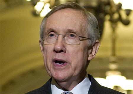 U.S. Senate Majority Leader Harry Reid (D-NV) talks to reporters at the U.S. Capitol in Washington in this file photo taken August 2, 2011. REUTERS/Jonathan Ernst/Files