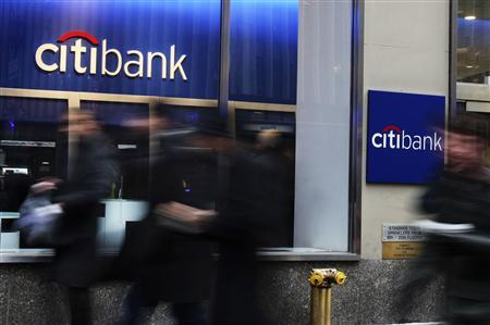 People walk by a Citibank branch in New York in this January 17, 2012 file photo. REUTERS/Shannon Stapleton/Files