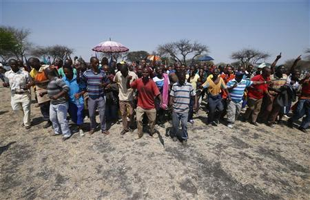 Striking platinum miners march near the Anglo-American Platinum (AMPLATS) mine near Rustenburg in South Africa's North West Province, in this file October 5, 2012 photo. REUTERS/Mike Hutchings