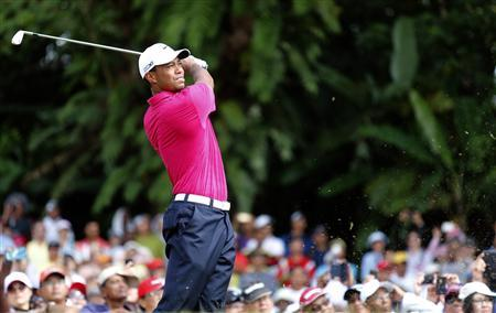 Tiger Woods of the U.S. tees off on the first hole during the third round of Malaysia's Asia Pacific Classic golf tournament in Kuala Lumpur October 27, 2012. REUTERS/Bazuki Muhammad