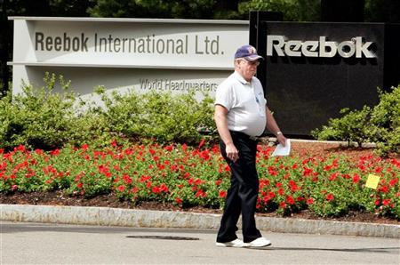 A security guard walks outside the world headquarters for Reebok in Canton, Massachusetts August 3, 2005. REUTERS/Brian Snyder