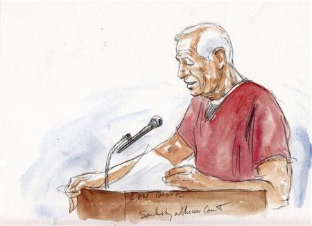 Former Pennsylvania State University football coach Jerry Sandusky addresses the court in this courtroom sketch during his sentencing hearing in Bellefonte, Pennsylvania October 9, 2012. REUTERS/Art Lien (