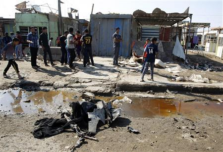 Residents inspect the site of a bomb attack in Baghdad October 27, 2012. Two blasts hit a Baghdad Shi'ite neighbourhood and a bus full of Iranian pilgrims on Saturday, killing at least 13 people on the second day of the Islamic Eid al Adha religious festival, police and hospital sources said. REUTERS/Thaier al-Sudani