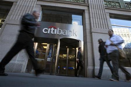 Passersby walk in front of a Citibank branch in New York, October 16, 2012. REUTERS/Keith Bedford