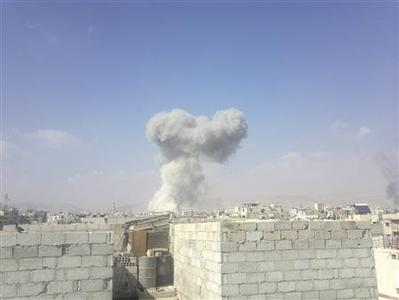 Smoke from what activists say was missile fired by a Syrian Air Force fighter jet loyal to Syria's President Bashar al-Assad is seen at Erbeen, near Damascus October 27, 2012. REUTERS/Maawia Al-Naser/Shaam News Network/Handout