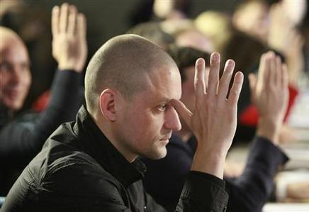 Opposition leader Sergei Udaltsov votes during the first meeting of the Russian opposition Coordination Council in Moscow October 27, 2012. The Council was elected by opposition supporters in an Internet vote earlier this month and tasked with trying to mount a structured challenge to Putin, who assumed the presidency in May for a six-year term. REUTERS/Sergei Karpukhin