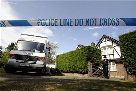 A police officer stands by a cordon close to the house of Saad al-Hilli and his family in Claygate near London September 13 2012. REUTERS/Luke MacGregor