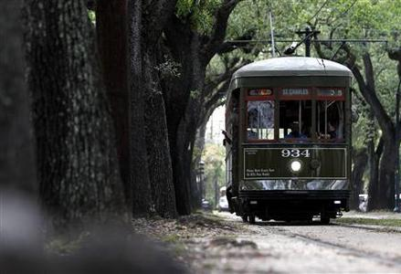 A Street Car travels down St. Charles Ave. in New Orleans in this May 25, 2012 file photo. New Orleans, once crisscrossed by sprawling streetcar lines, is embracing anew the rumbling reminder of the city's storied and elegant past by restoring old lines and seeking to build new ones. Picture taken May 25, 2012. REUTERS/Sean Gardner/Files