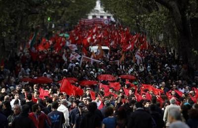 Tens of thousands protest against austerity in Rome