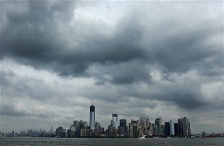 Clouds gather over New York October 27, 2012. REUTERS/Carlo Allegri