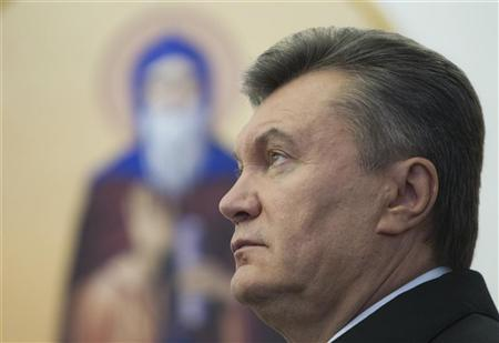 Ukrainian President Viktor Yanukovich attends a ceremony to mark the opening of a church on a military base in Kiev October 26, 2012. REUTERS/Mykhailo Markiv/Presidential Press Service/Handout
