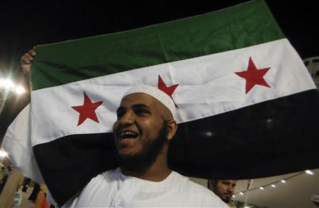 A Syrian Muslim pilgrim shouts slogans against Syria's President Bashar al-Assad after casting seven stones at a pillar that symbolises Satan during the annual Haj pilgrimage in Mina, near the holy city of Mecca October 27, 2012. REUTERS/Amr Abdallah Dalsh