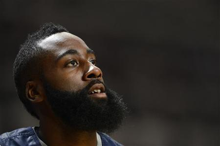 U.S. Olympic basketball player James Harden watches during a training session ahead of the London 2012 Olympic Games at the M.E.N Arena in Manchester, northern England, July 18, 2012. REUTERS/Nigel Roddis