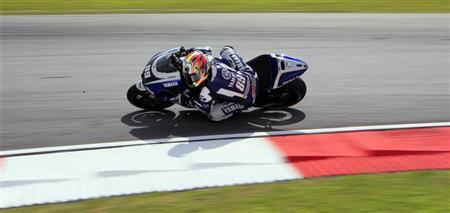 Yamaha MotoGP test rider Katsuyuki Nakasuga of Japan takes a corner during the first free practice session at the Malaysian Grand Prix at Sepang International Circuit near Kuala Lumpur October 21, 2011. REUTERS/Samsul Said