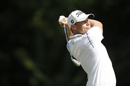 Nick Watney of the U.S. tees off on the first hole during the final round of the Malaysia's Asia Pacific Classic golf tournament in Kuala Lumpur October 28, 2012. REUTERS/Bazuki Muhammad