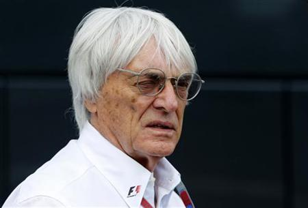 Formula One commercial supremo Bernie Ecclestone looks on at the start of the qualifying session of the Belgian F1 Grand Prix in Spa Francorchamps September 1, 2012. REUTERS/Francois Lenoir/Files