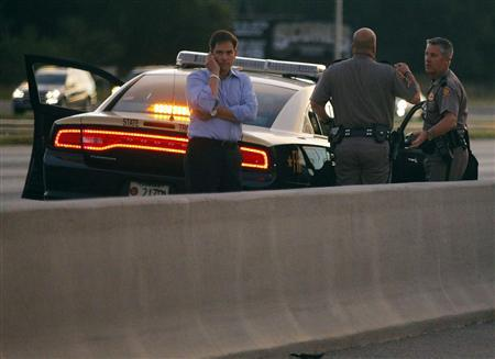 U.S. Senator Marco Rubio stands on the side of Interstate 4, where the motorcade carrying U.S. Republican presidential nominee Mitt Romney stopped, in Lakewood Crest, Florida October 27, 2012. REUTERS/Brian Snyder