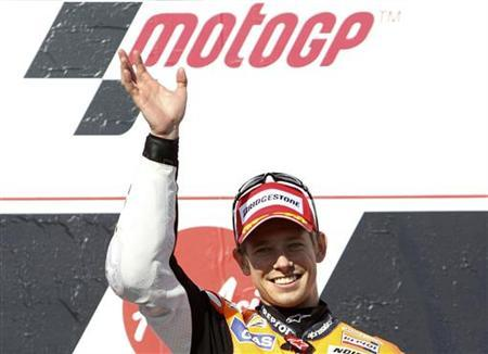 Honda MotoGP rider Casey Stoner of Australia celebrates winning the Australian Motorcycle Grand Prix at Phillip Island October 28, 2012. REUTERS/Brandon Malone