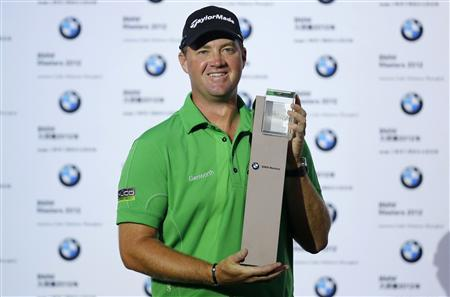 Peter Hanson of Sweden poses with his trophy after winning the BMW Masters 2012 golf tournament at Lake Malaren Golf Club in Shanghai, October 28, 2012. REUTERS/Aly Song