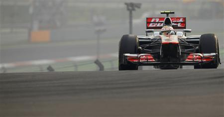 McLaren Formula One driver Lewis Hamilton of Britain drives during the Indian F1 Grand Prix at the Buddh International Circuit in Greater Noida, on the outskirts of New Delhi, October 28, 2012. REUTERS/Ahmad Masood