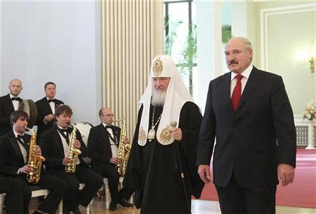 Belarus President Alexander Lukashenko (R) and Kirill, the Patriarch of Moscow and All Russia, walk during their meeting in Minsk October 14, 2012. REUTERS/Nikolay Petrov/BelTA/Handout