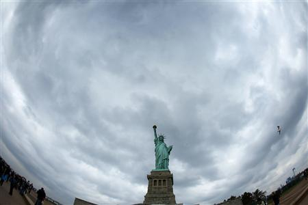 The Statue of Liberty is seen in New York October 27, 2012. The statue was closed for a year-long project that was the second phase of planned work to improve the visitor's experience and safety while touring the interior of the monument. Starting Sunday visitors will once again be able to climb to Lady Liberty's crown. REUTERS/Carlo Allegri