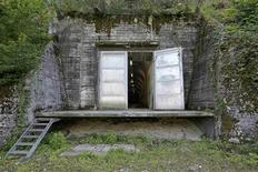 A view through an opened metal door shows the entrance into a 57-year old disused military bunker near the central Swiss town of Alpnach, near Lake Lucerne, August 27, 2012. The bunker, marketed as a site to store valuables and on offer at 386,000 Swiss francs ($417,000), could relieve a huge concentration of costly paintings at the world's biggest fine art vault in Geneva, the storage option of choice for wealthy buyers worldwide. REUTERS/Arnd Wiegmann