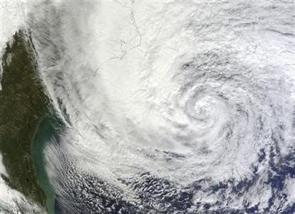 Hurricane Sandy is seen on the east coast of the United States in this NASA handout satellite image taken at 1600 GMT on October 28, 2012. REUTERS/NASA Earth Observatory/LANCE MODIS Rapid Response Team/Handout